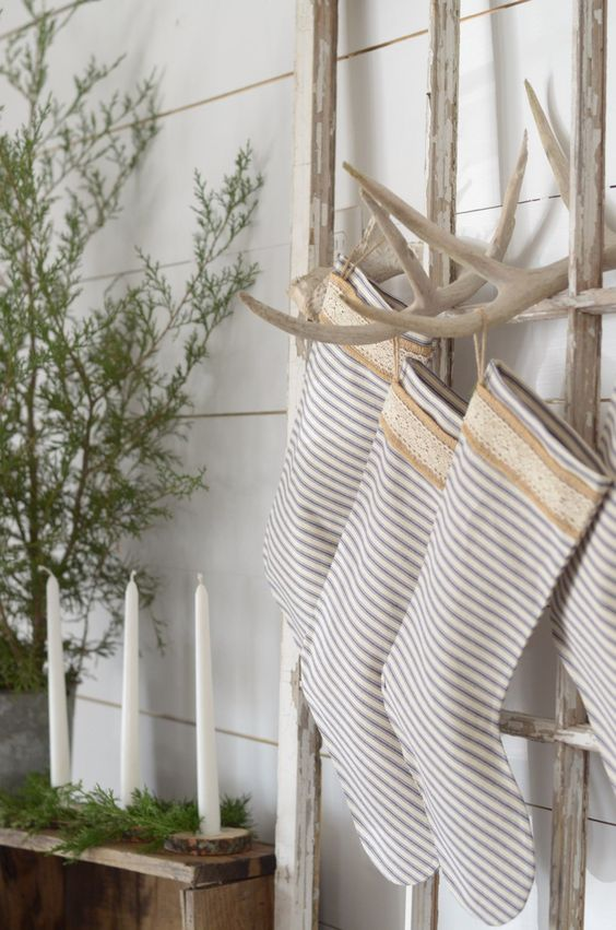 A simple farmhouse christmas. using antlers to hang stockings