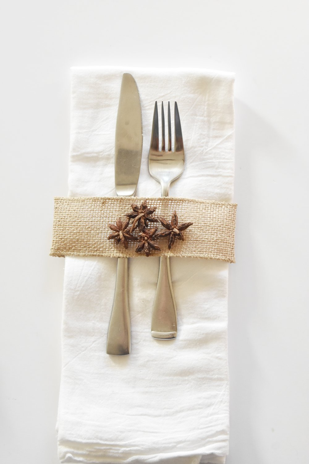 DIY Holiday Napkin Idea with Burlap Ribbon and Anise Stars. Beautiful and Simple Thanksgiving Table Setting. Rustic, Country, Simple, Farmhouse, Woodsy