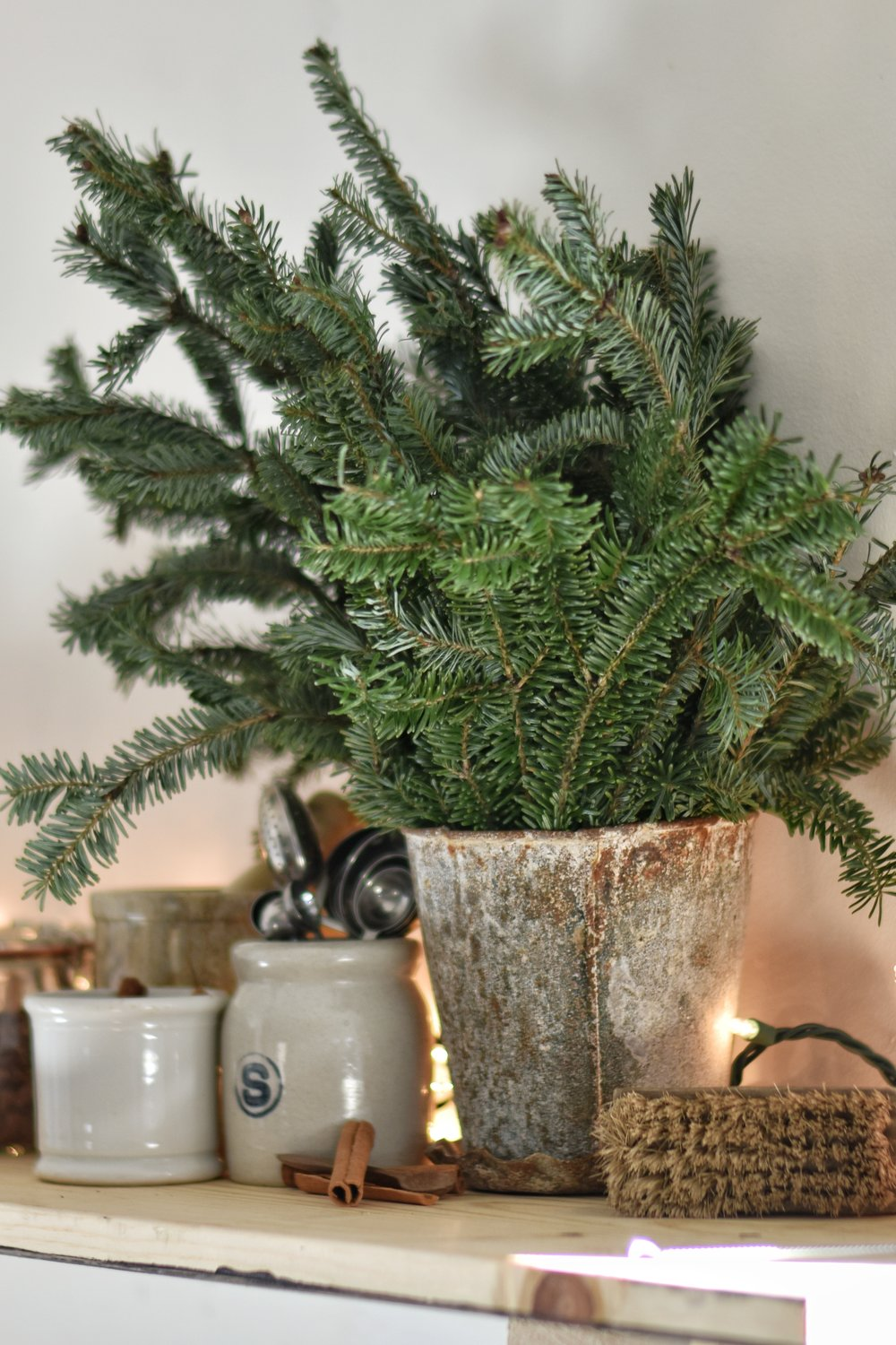 How to keep your Christmas Greenery from falling off and into the floor. An easy tip to preserving your Christmas greenery.