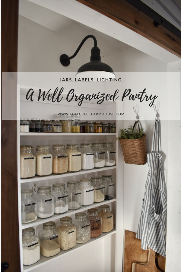 An organized pantry with where to find jars, the label maker and the light.