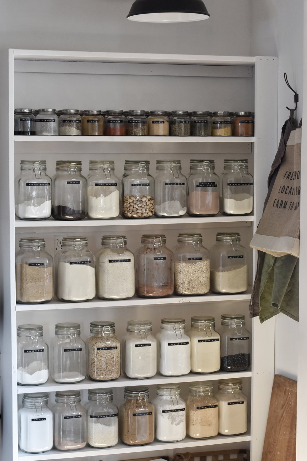 A well organized pantry filled with jars of spices and herbs to create healthy meals | Rocky Hedge Farm