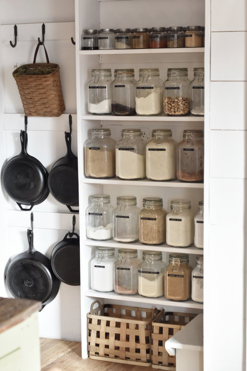 Pantry essentials for cook from scratch healthy meals. A well organized pantry filled with jars that holds spices and herbs to easily see what you need | Rocky Hedge Farm