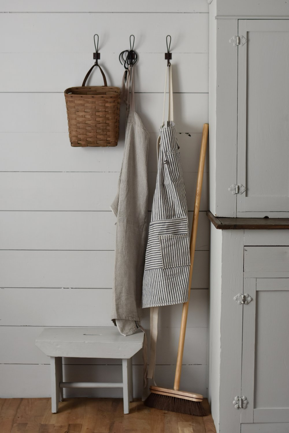 wooden broom - beautifully  leaned against the wall or the cabinet. it is the prettiest broom within easy reach for lifes everyday messes.