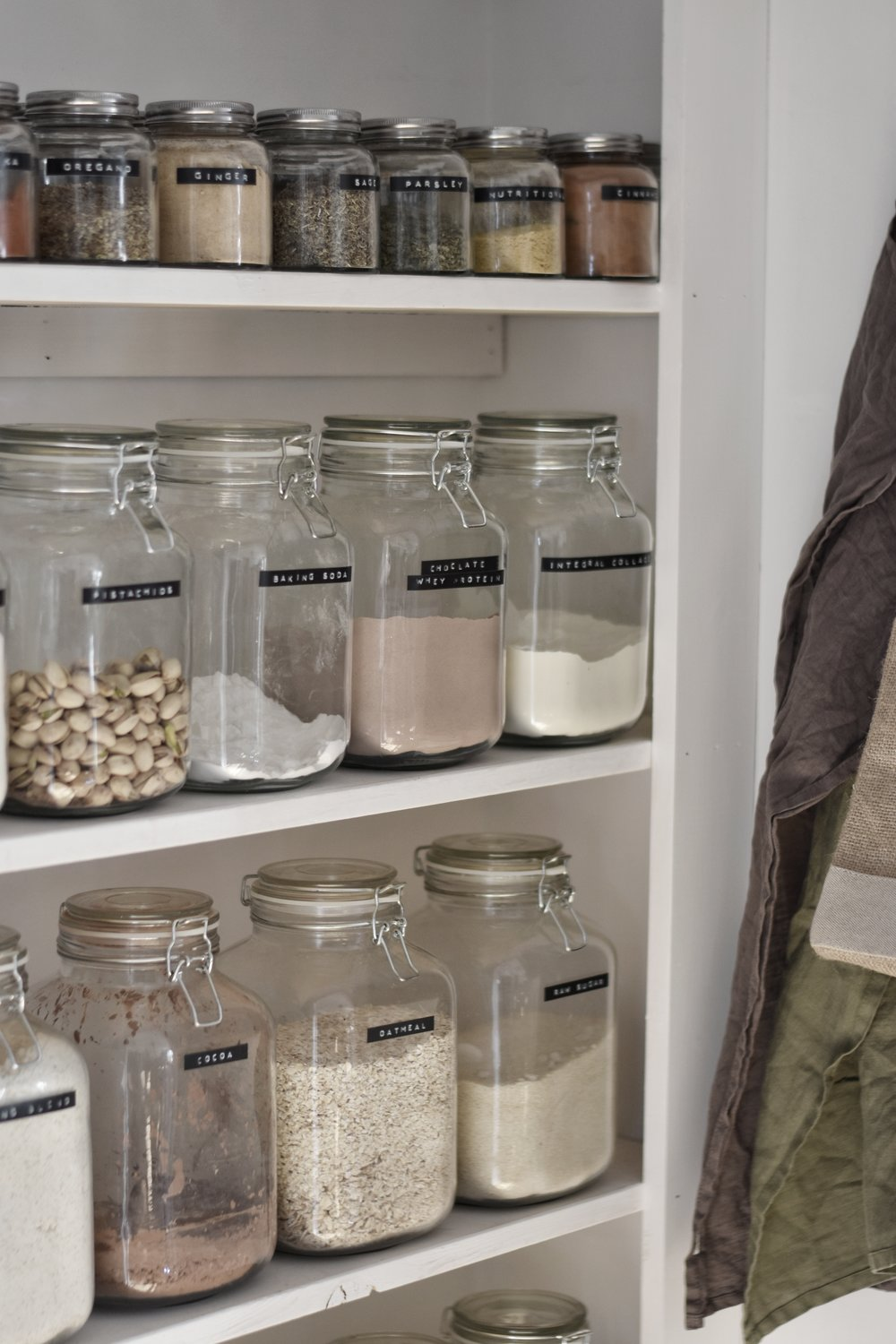 large pantry jar - the large jars hold 67 ounces. they have the seal and a latching metal clasp.