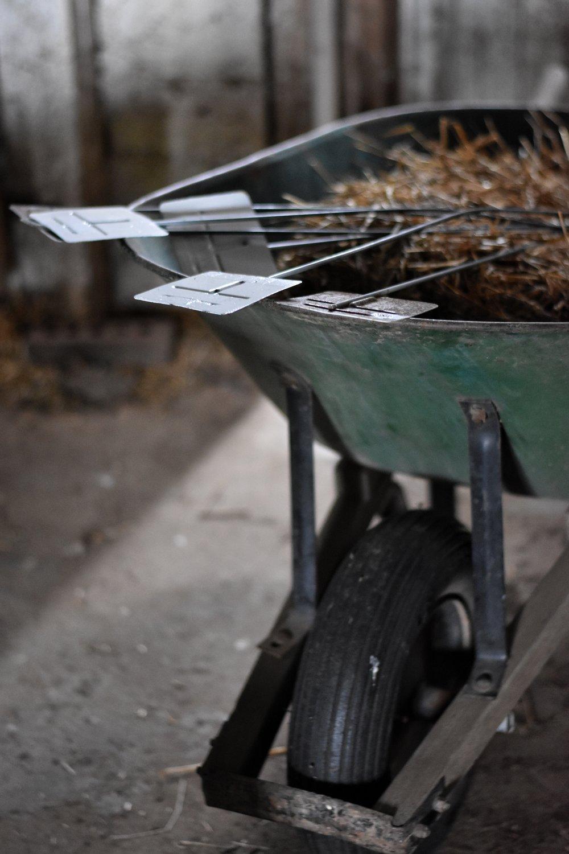 Vintage garden markers and an old green wheelbarrow. garden simplicity