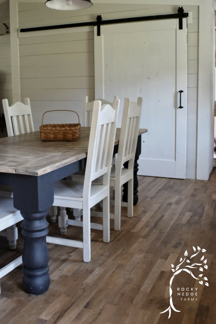 Rustic Sliding Barn Door for the Kitchen Pantry painted white.