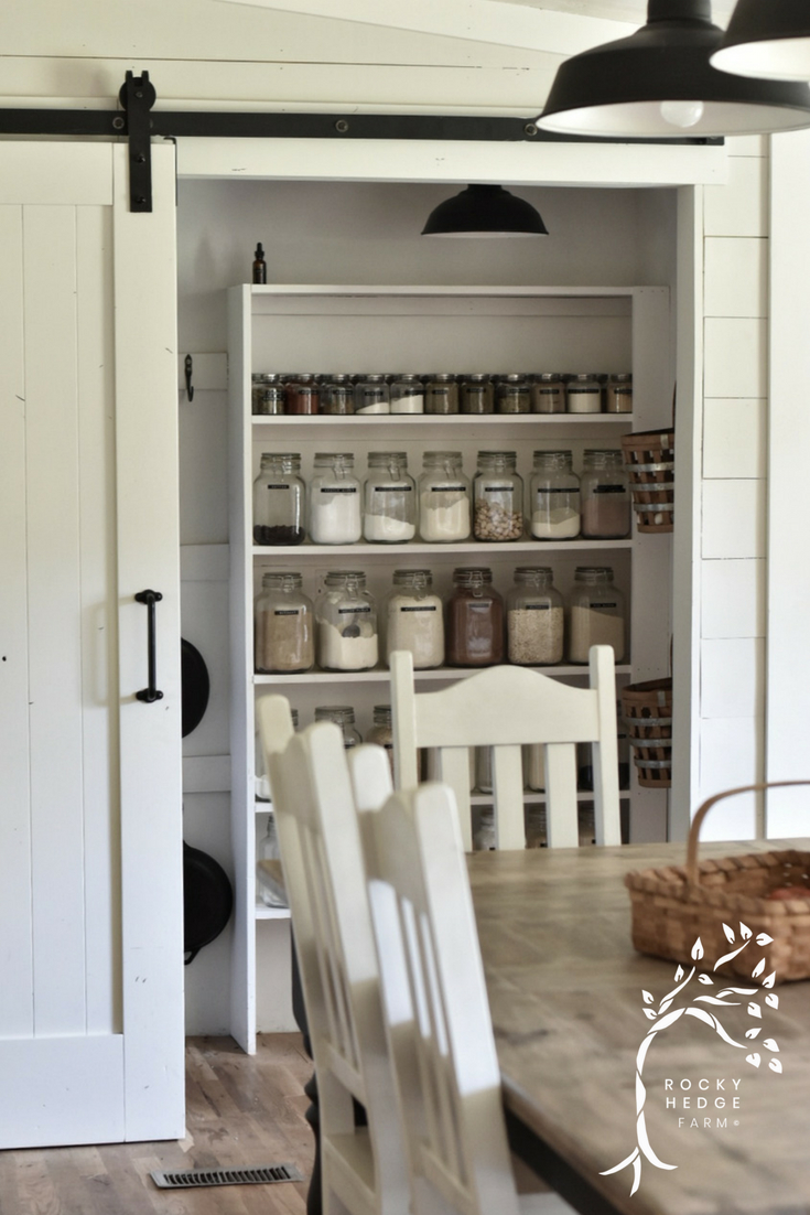 Organized Walk In Pantry with Sliding Barn Door