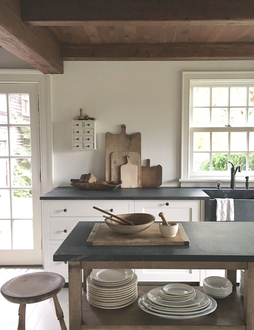 Farmhouse Modern Shaker Style Kitchen. Wood beams, White Walls, Wooden Cutting Boards, Vintage Finds for the kitchen.