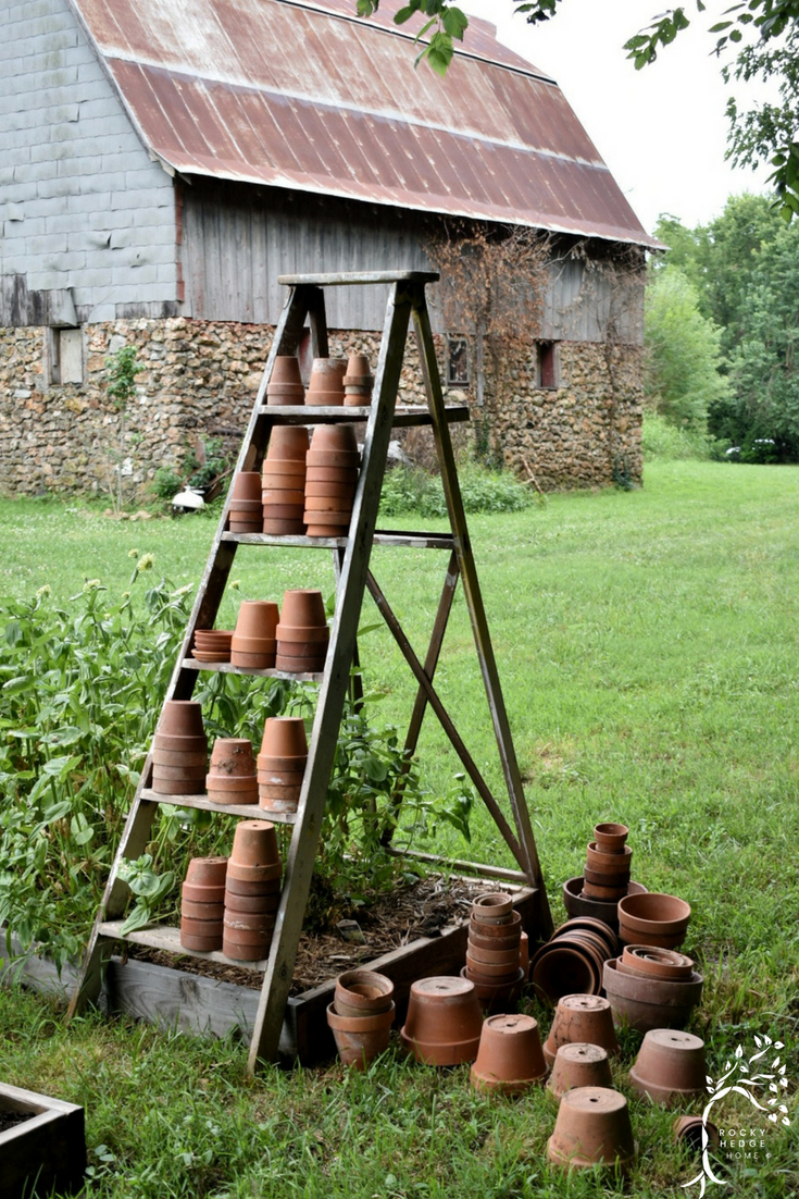 Create A Beautiful Flower Garden Using Vintage Finds Like An Old Ladder And  Terra Cotta Pots