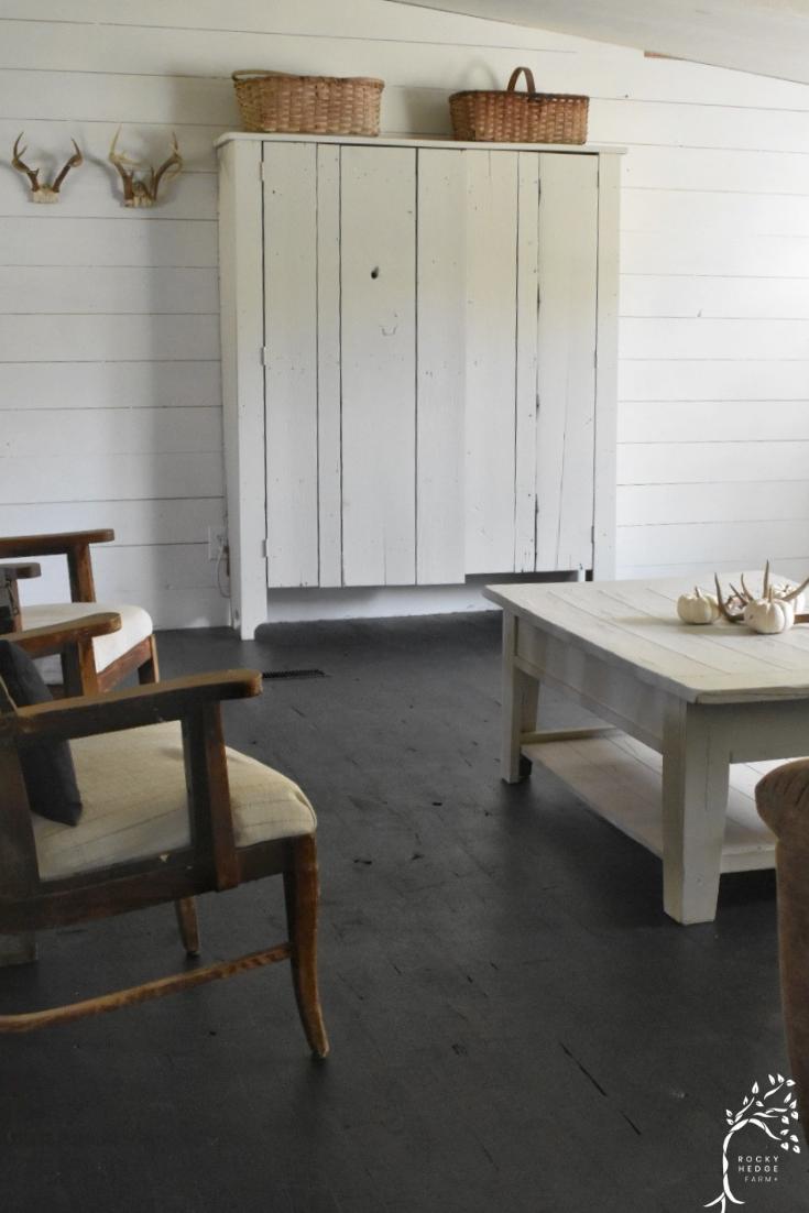 Black farmhouse style painted hardwood floors