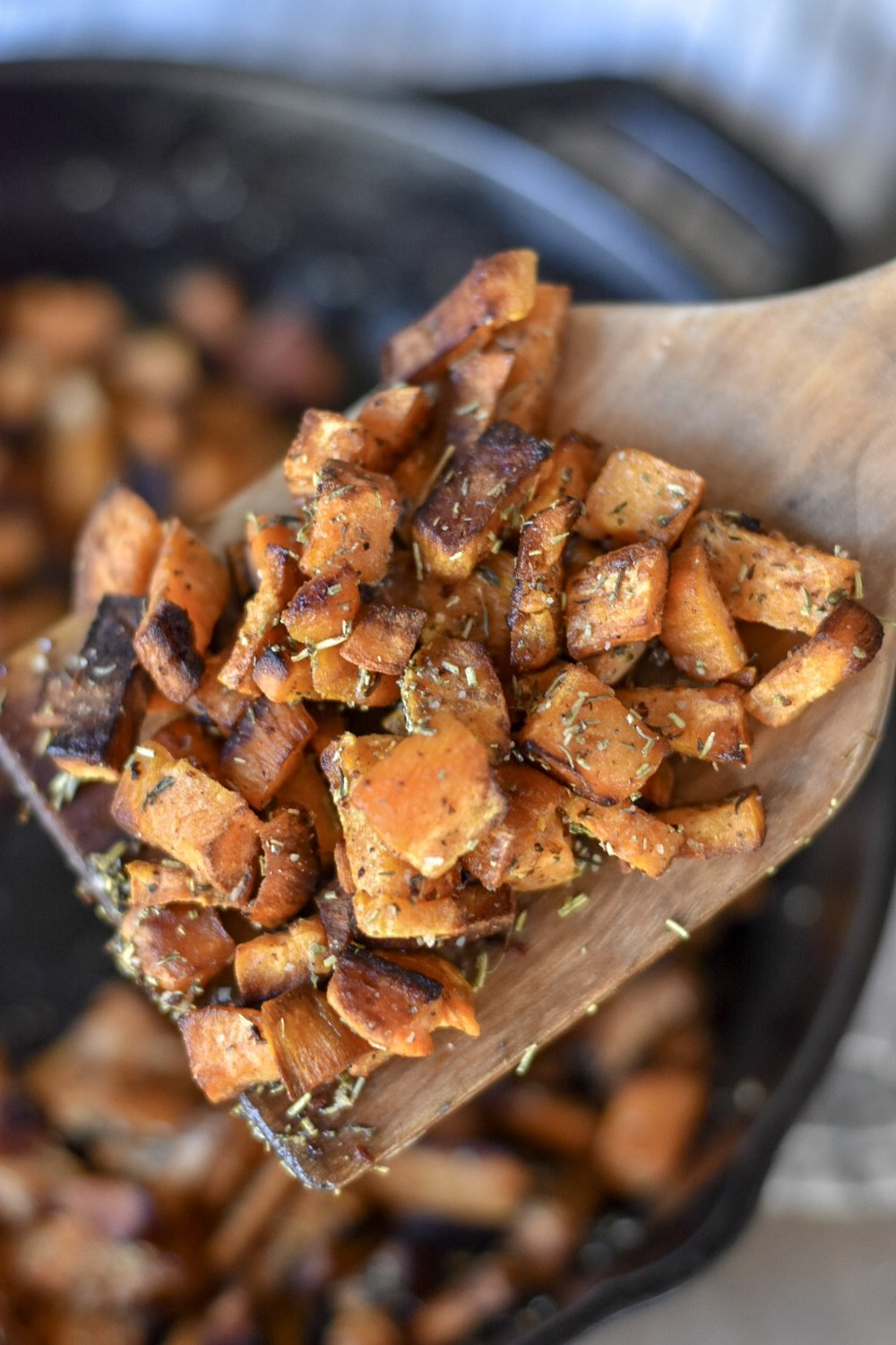 Crispy Cast Iron Sweet Potato Recipe. Get perfectly crisp sweet potatoes by frying them up in a cast iron skillet with herbs for a healthy side dish | Rocky Hedge Farm