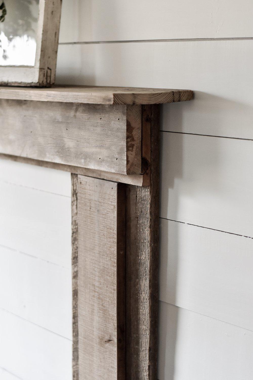 Fake rustic farmhouse faux mantel made for cheap by using barn wood.JPG