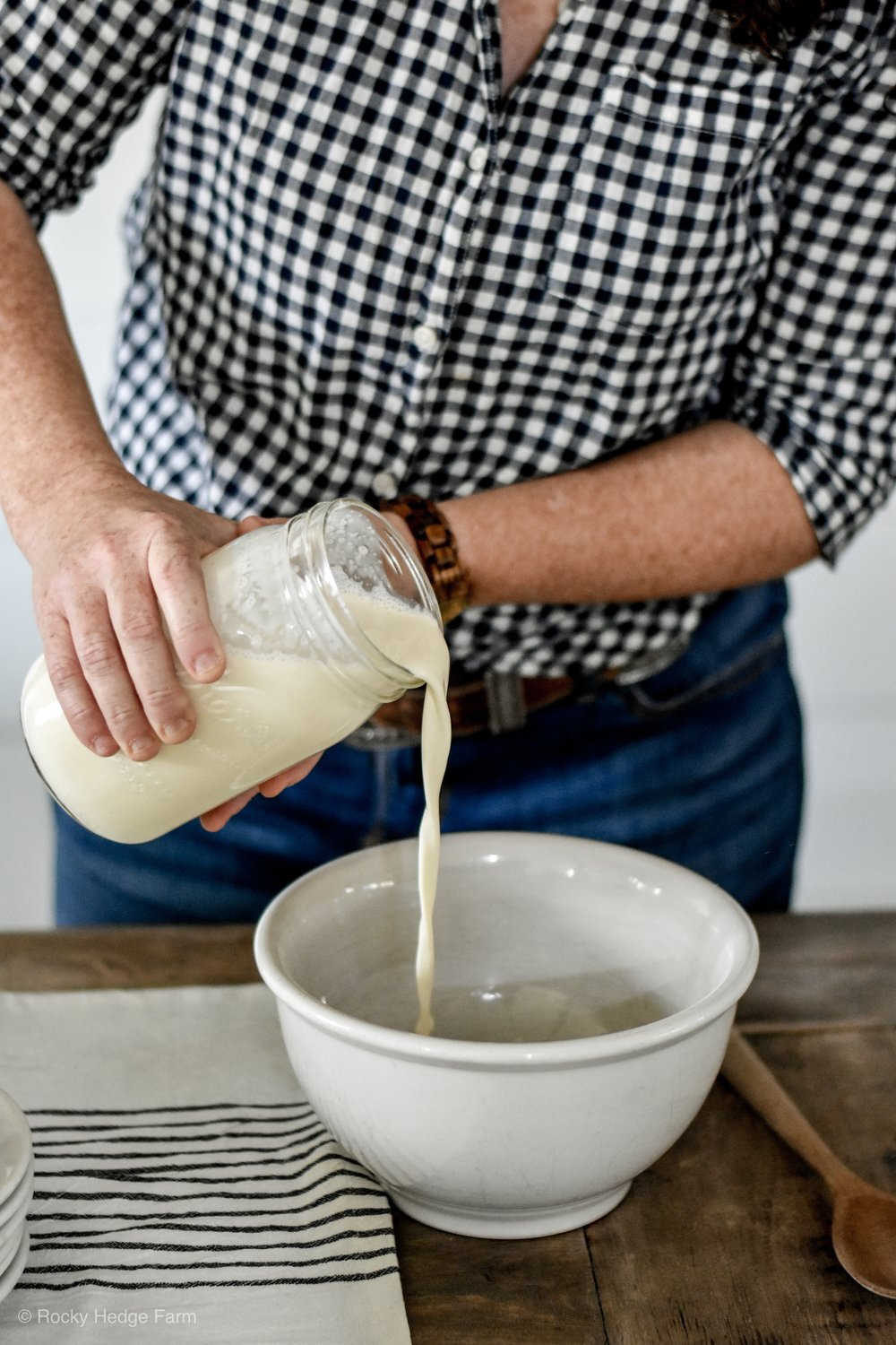 Pouring fresh raw cream from milk | Rocky Hedge Farm