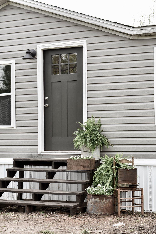 Double Wide Mobile Home Exterior Black Front Door. | Rocky Hedge Farm