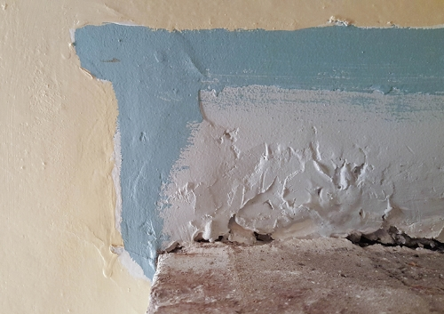Where the wall was painted around the mantle.