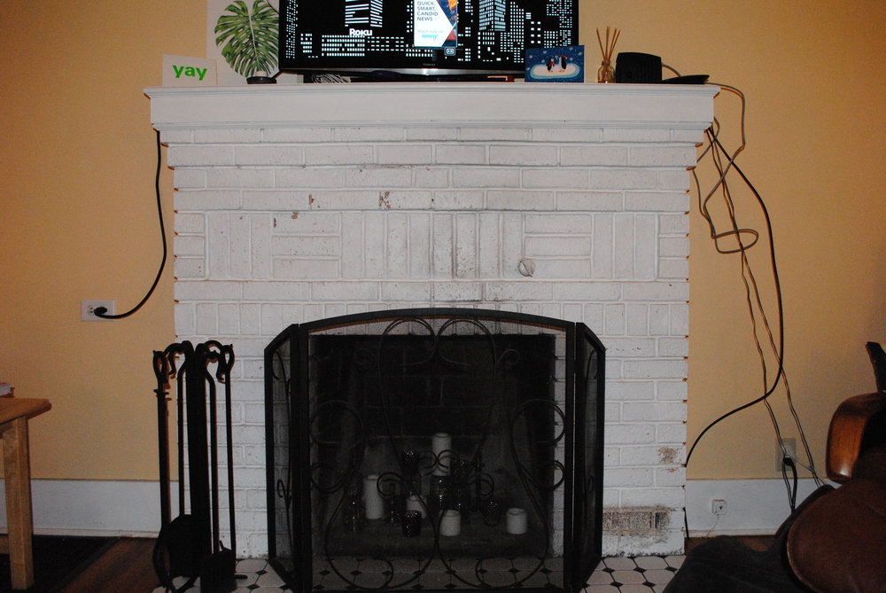 The old mantel. No amount of editing or cropping can save the ugly on show here. It's so ugly we just removed it, threw it away, and use bare brick.