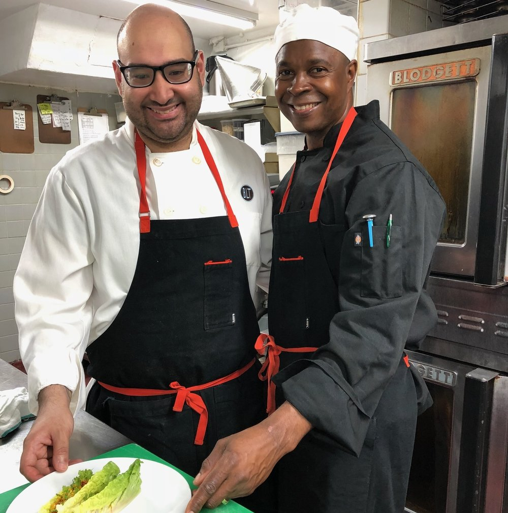 Cornel Robinson (program graduate) and mentor Ham El-Wally prepare a summer corn medley.