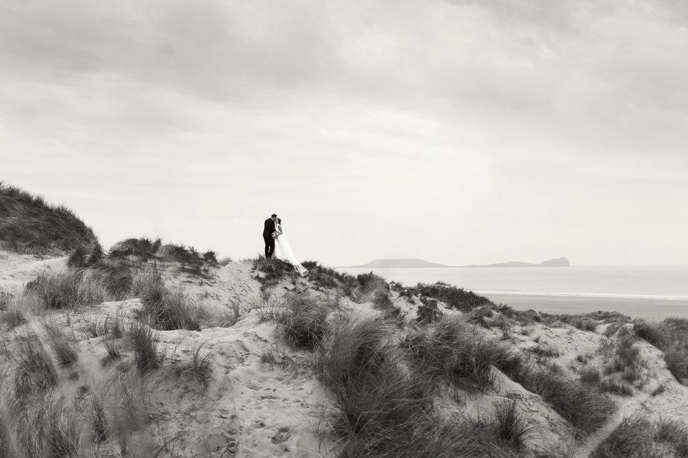 Wedding portraits at Llangennith beach, looking over towards Worm's head, Rhossili.