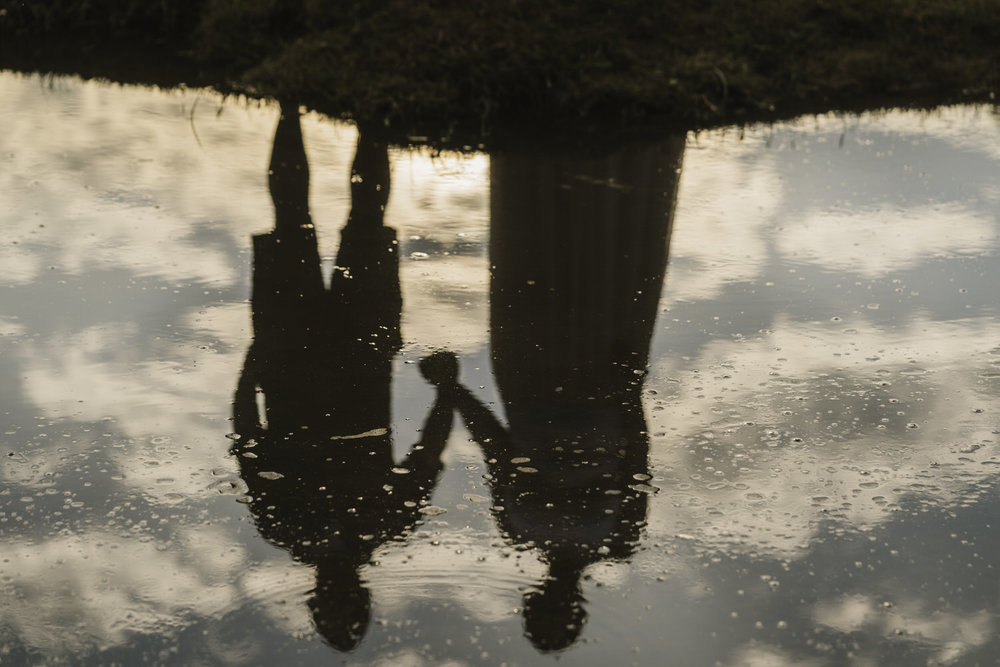 Upside down wet folk at Three Cliffs bay, Swansea.