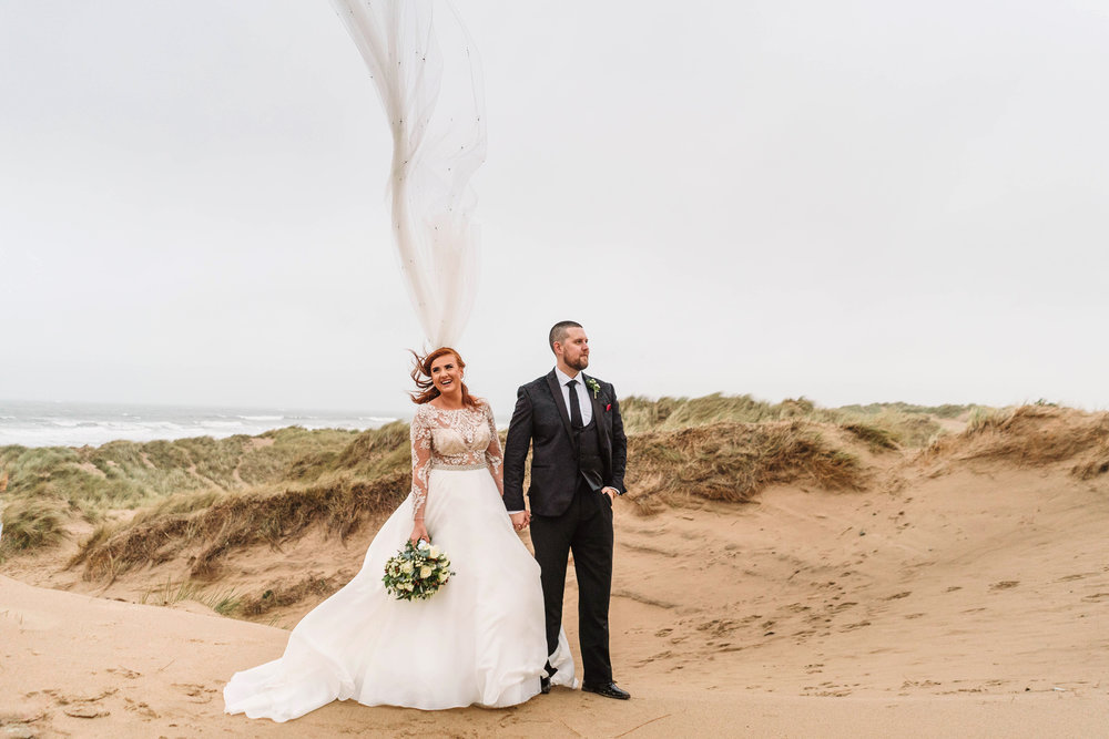 Just a little bit of wind for Alice & Mike's couples portraits at Llangennith beach in Gower before their reception awaiting them at  Fairyhill , Gower.