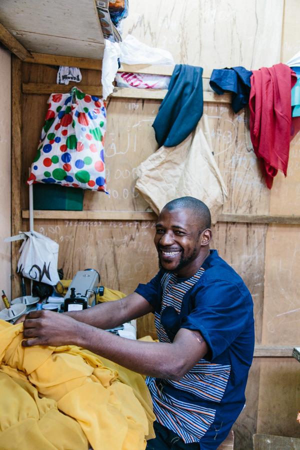 Alpha Ba, our lead tailor working in Dakar, Senegal.