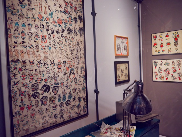 Tony D'Annessa's tattoo shop with original window shade flash used in the 1960's. Made to easily roll up if the police came looking for tattooists. In 1961, it became illegal in New York to be a tattooist.