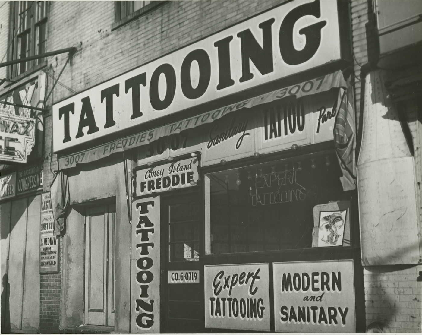 "Irving Herzberg, ""Tattoo shop of 'Coney Island Freddie' just prior to New York City's ban on tattooing"" (1961), digital print (courtesy Brooklyn Public Library)"