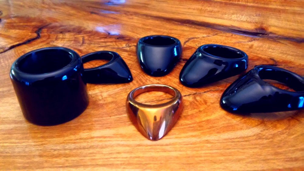 Our current five styles, from left to right: Manchu, Byzantine, Ottoman, Hybrid, and Grooved. Seen at center is the Byzantine in Bronze (the historically correct material for the ring we modeled our Byzantine from).