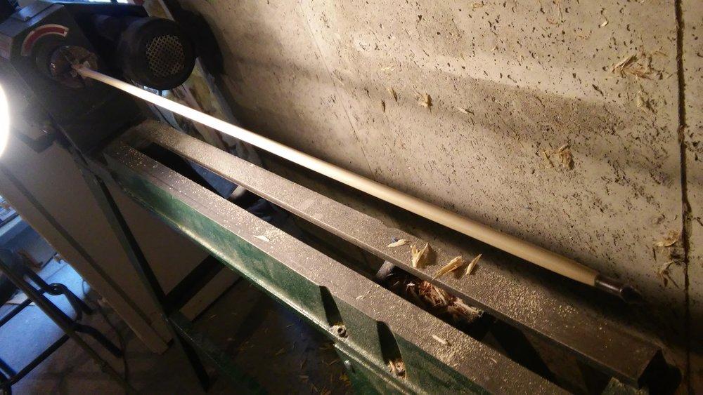 Finish sanding shafting on the lathe