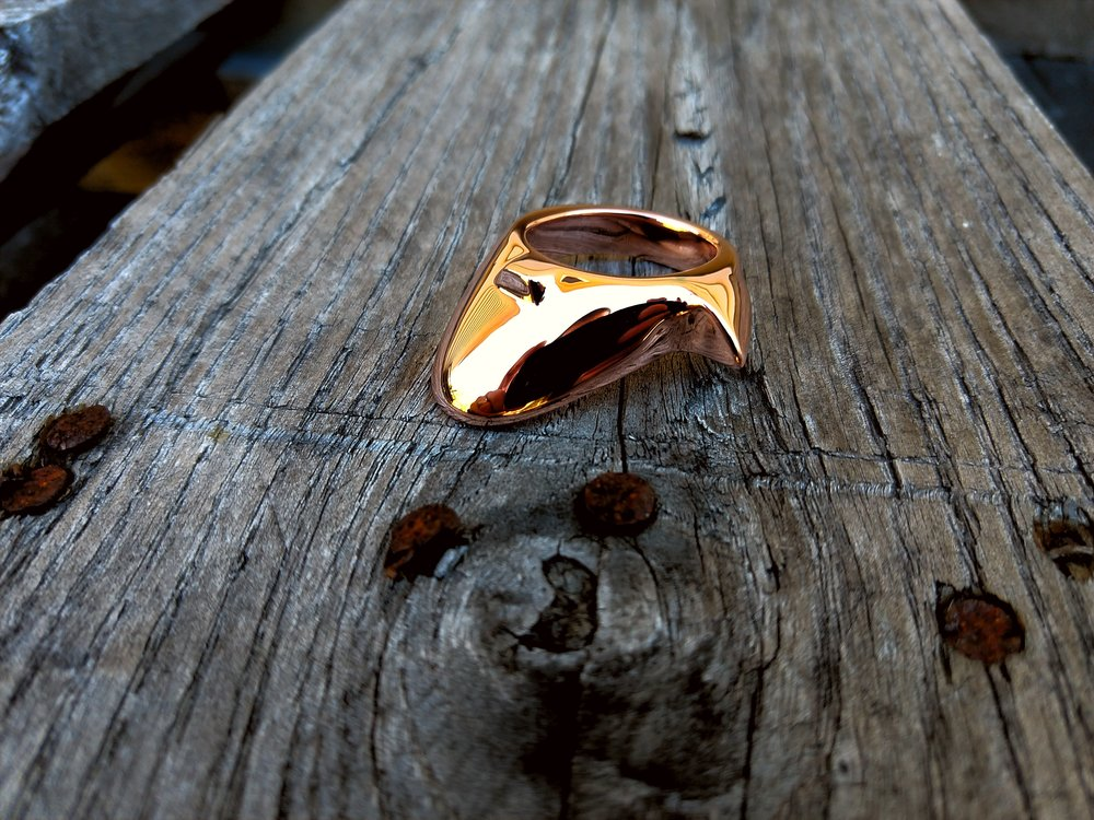 A fully bespoke ring designed for a customer. This ring offers both tongue and spur, vaguely similar to the King Rui style ring.