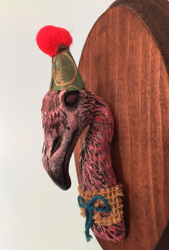 MEMORIES OF FLORIDA Flamingos and sullied beauty.... I sculpted this little flamigo  by hand with clay. I use no molds in my process so this guy is one of a kind. He comes ready to party with a little paper hat I made by hand. He's mounted on a wood plaque and ready to hang on your wall.