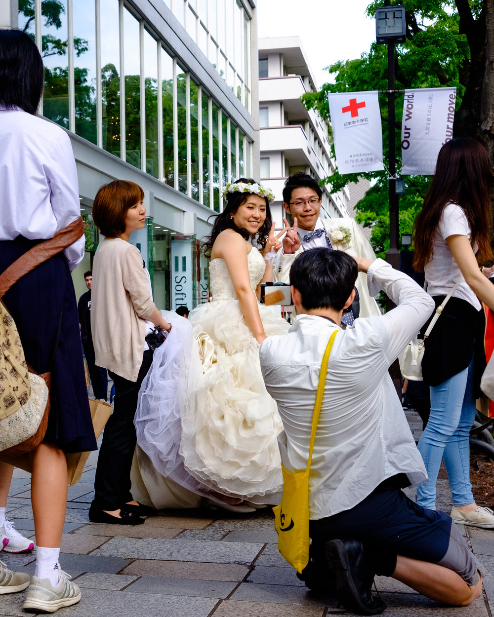Not a sight you see every day - I was sitting faffing around with my camera bag next to a crossing in Harijuku when this couple stopped waiting to cross the road and their photographer decided it was time to grab some photos.