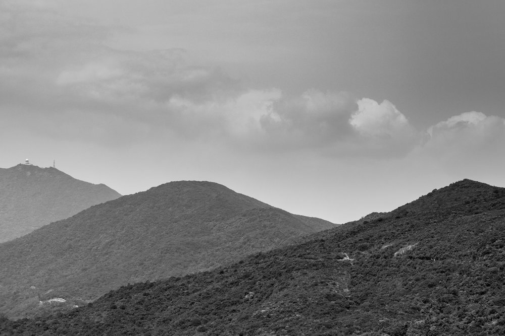 The haze in the air probably isn't great for hiking but it does make for some striking views like this I took when hiking along the Dragon's Back Trail in Hong Kong. I converted to black and white as it's really about the tones rather than the colours.