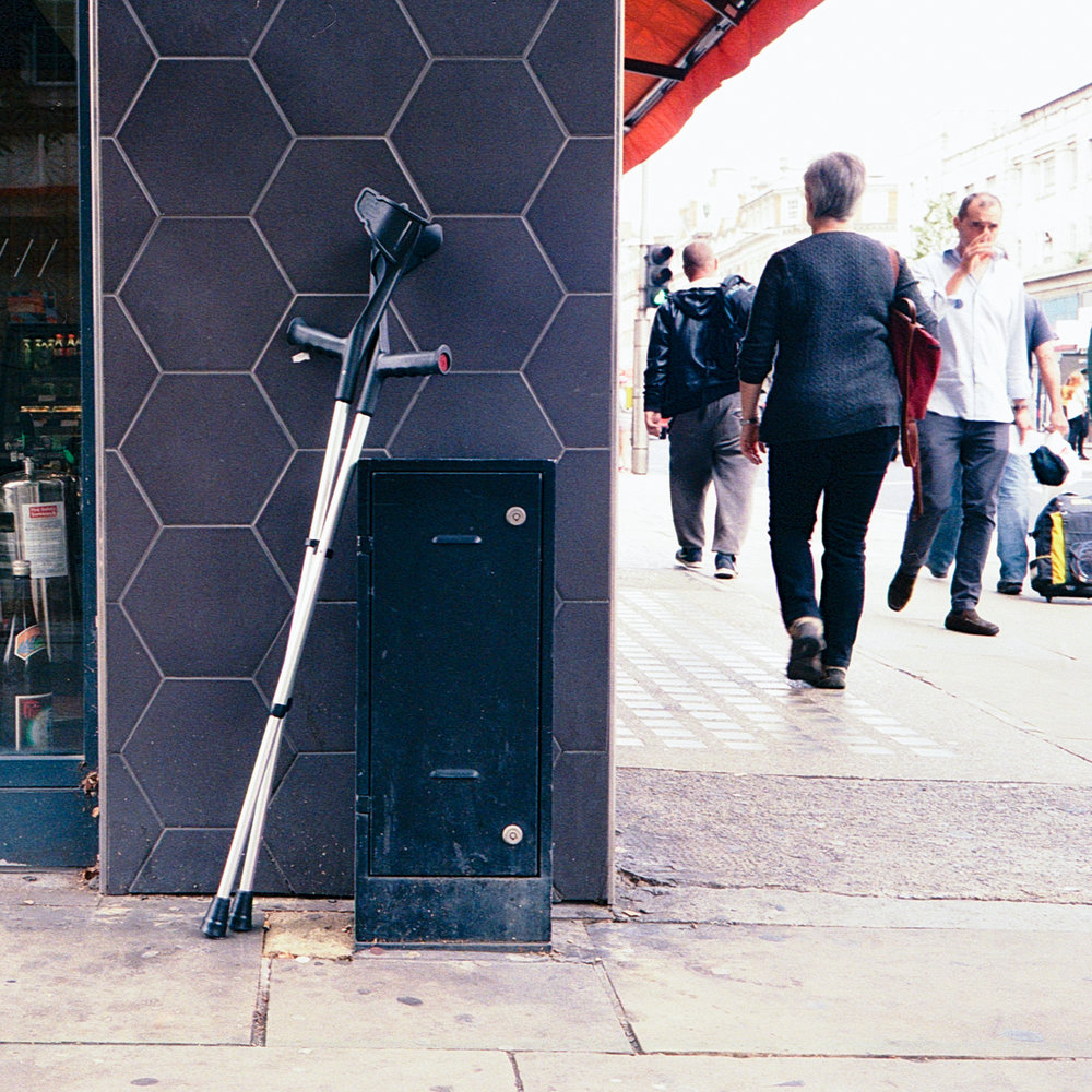 I have no idea why someone appeared to have abandoned a pair of walking sticks on Kensington High Street but they did.