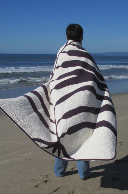 quilt at beach on Mary.jpg