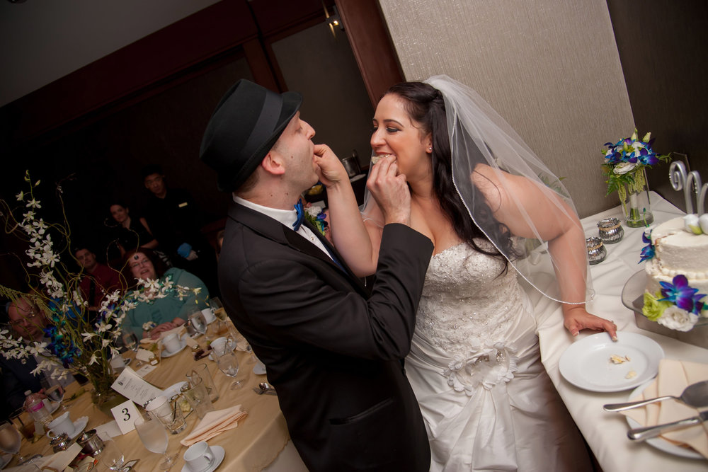 Bride & Groom Eating Cake.jpg