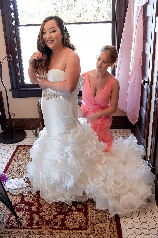 Bride getting into dress.jpg