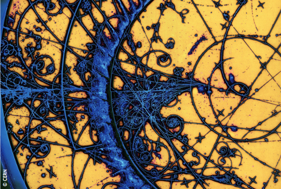 """The curling tracks of subatomic particles"". Photo taken by CERN using the Big European Bubble Chamber."