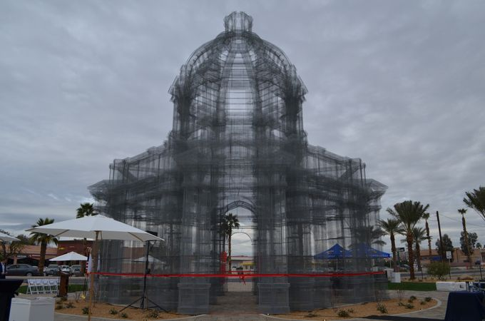 Etherea - Artist: EDOARDO TRESOLDINortheast Corner of Cesar Chavez Street and Sixth Street, Coachella, CAEdoardo Tresoldi installed three wire-mesh sculptures at the 2018 Coachella Music Festival, whose translucency weaved onto the festival grounds something that wasn't really there: neoclassical-and Baroque-inspired architecture. One of the structures has been donated by the festival to the city of Coachella as a permeant art installation. The sculpture breathes through the clouds and the wind, transferring the cosmic archetype of the sky into ephemeral domes through the language of classic architecture. The broken rhythms of the wire mesh generate sequences of architectural abstractions and amplified points of view. The optical effect changes with the light and atmospheric conditions as well as the perspective of the viewer. Etherea offers a dreamlike experience, a portal for contemplation, and an encounter between human and sky, which grows and shrinks as you move between the structures.