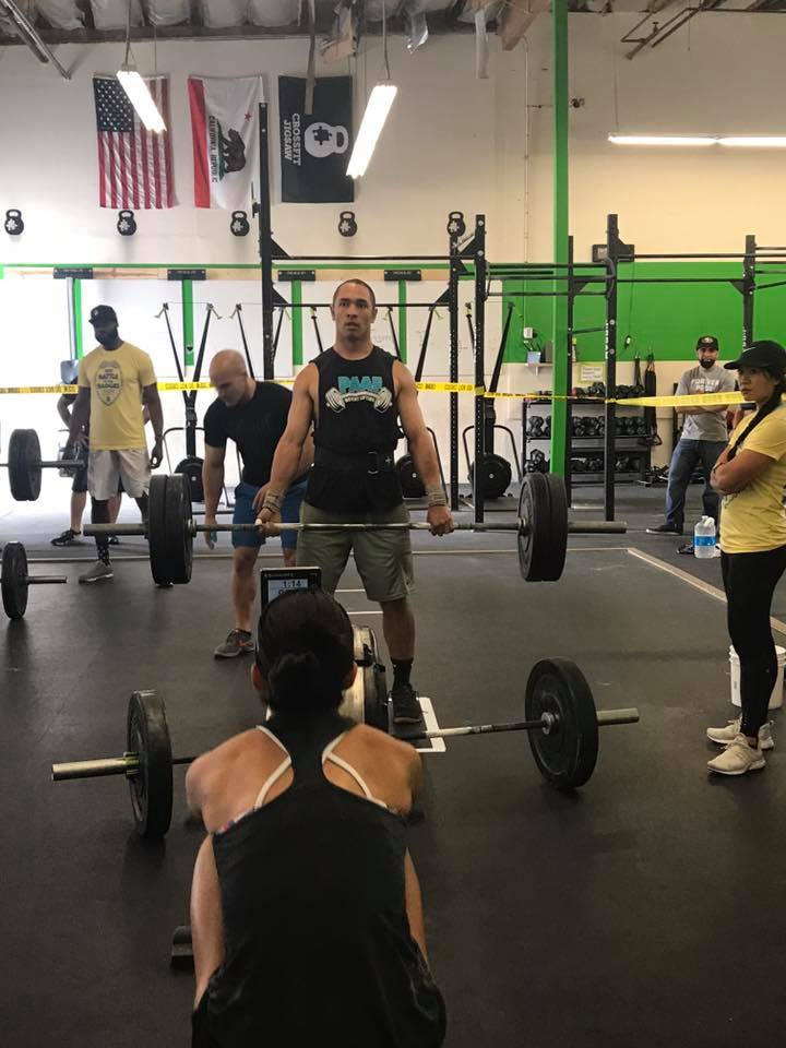 Battle of the badges partner holding a deadlift