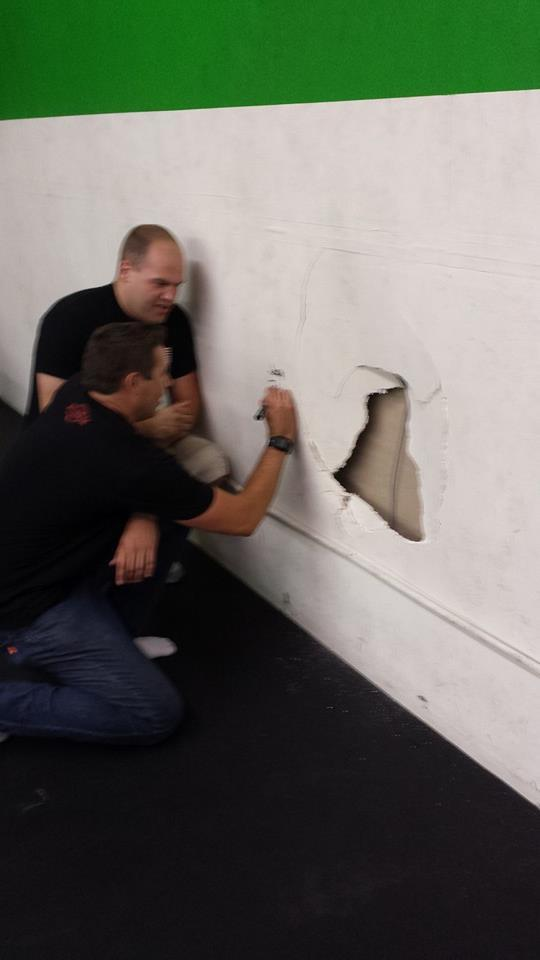 John signing the wall where Josh's head went into it....