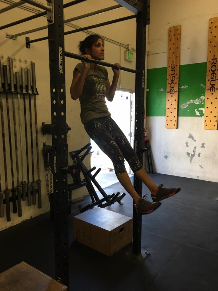 Suneet showing great range of motion at the top of a pull-up