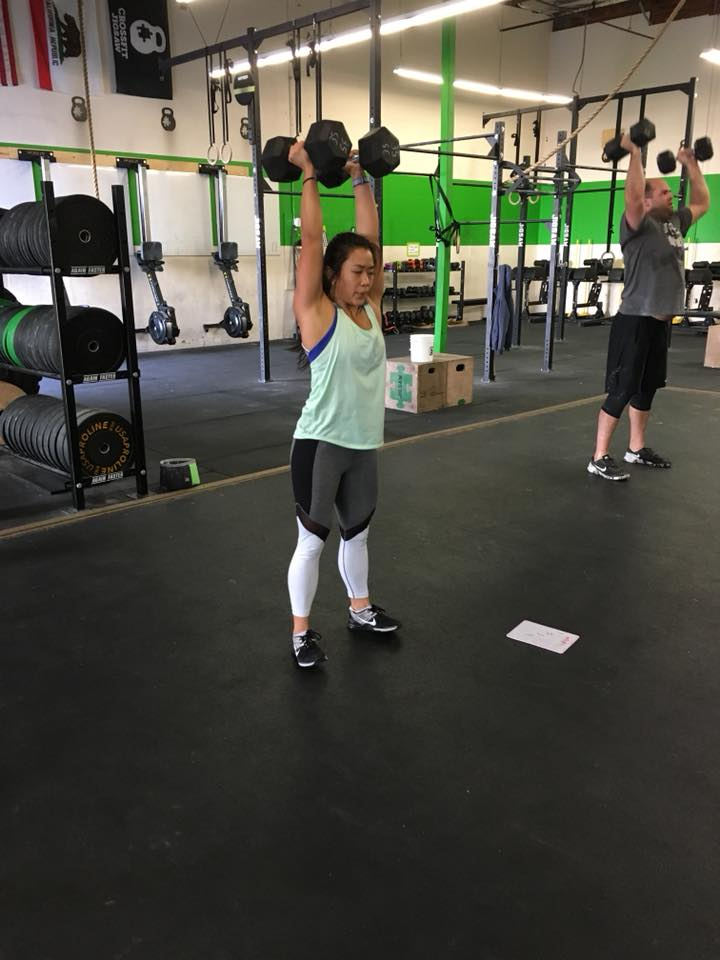 Coach Samantha making dumbbell thrusters look like a breeze