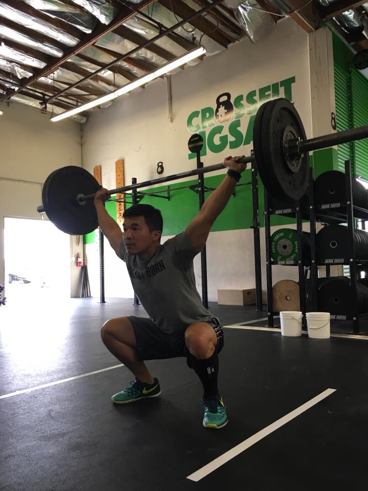 Cary in a great catch position while working snatch drills.