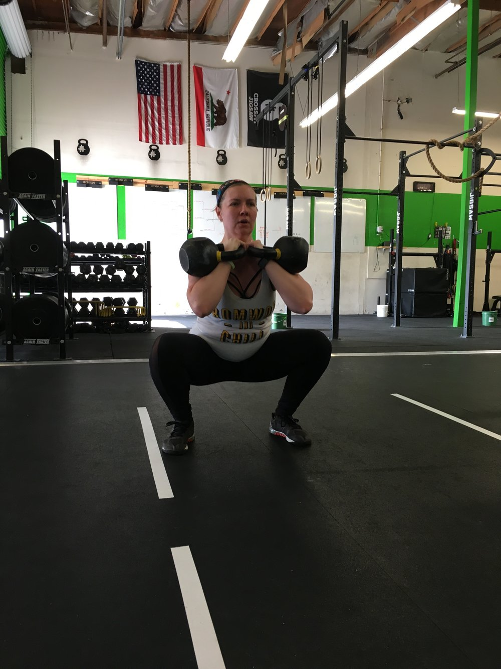 Jay working a pause squat with Kettlebells