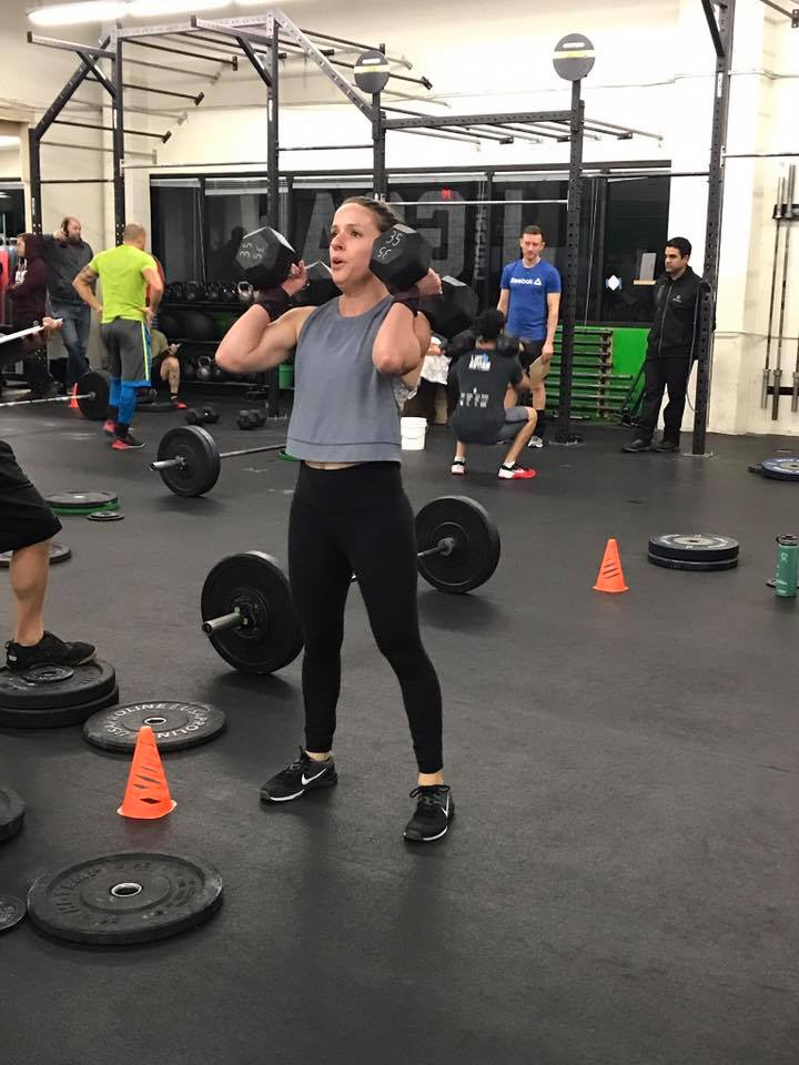 Jamie setting herself up to move those dumbbells...
