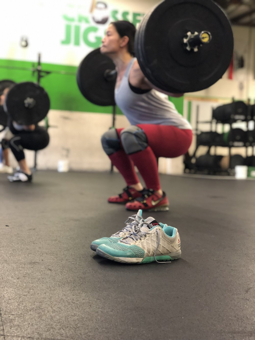 Kat Sun with her old lifting shoes to help her get into better positions!