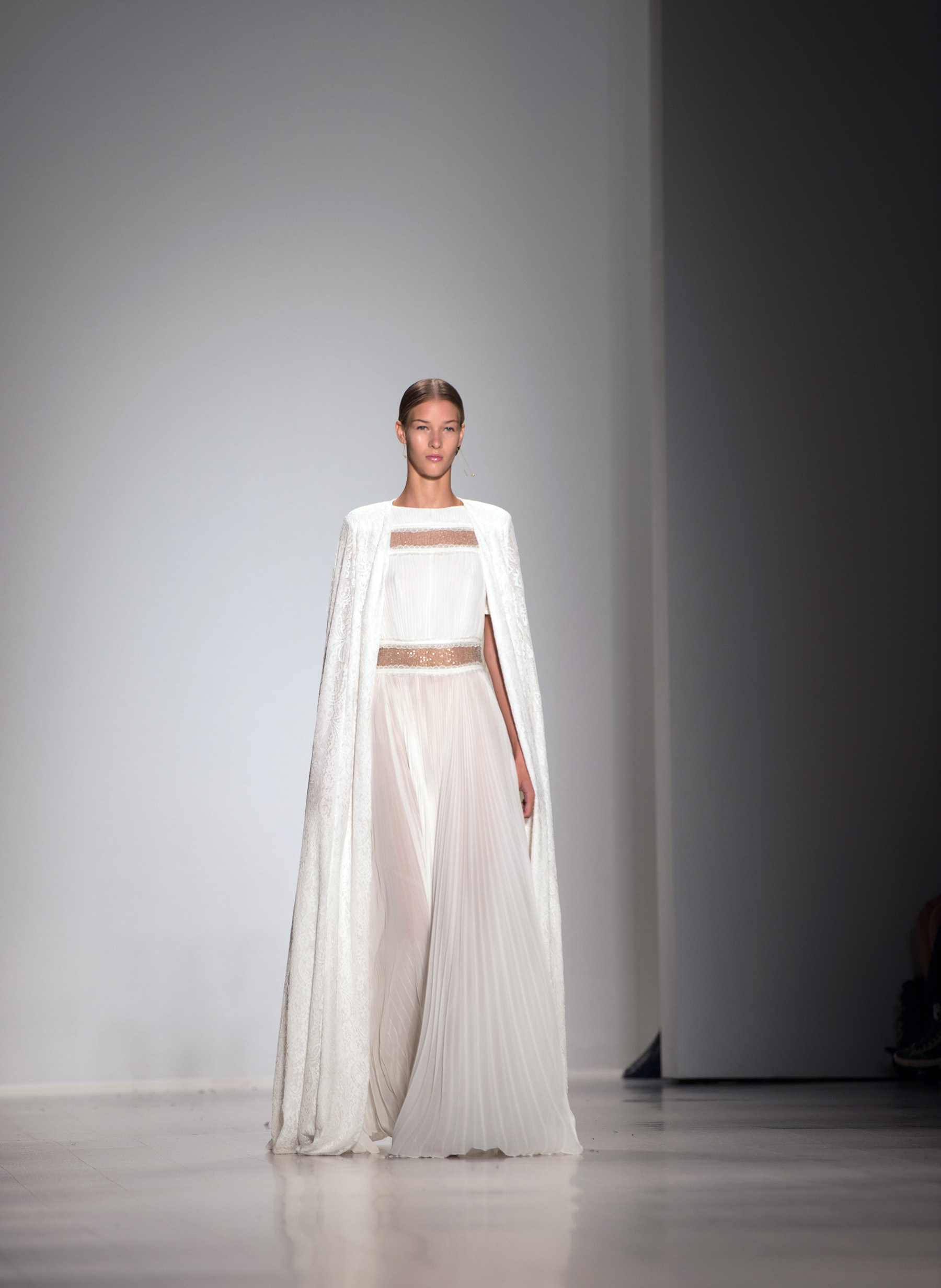 A model walks the runway at the TADASHI SHOJI Spring/Summer 2015 Fashion show during New York Fashion Week.