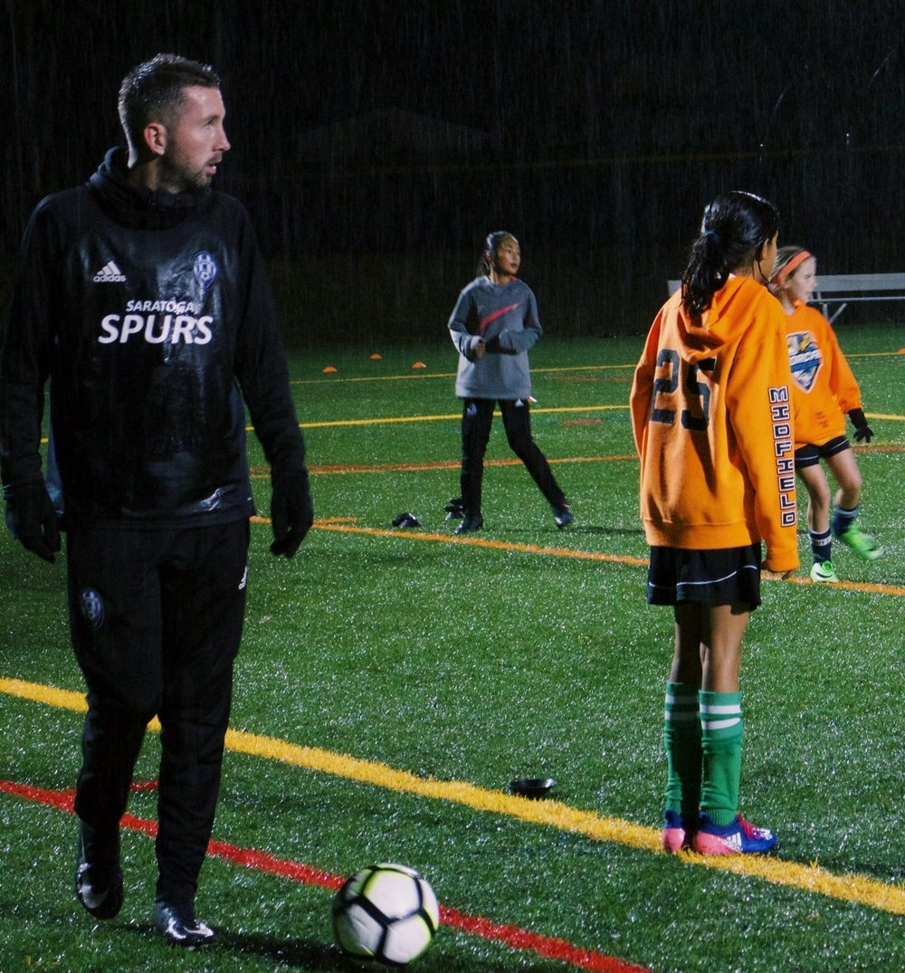 Saratoga Spurs Technical Director Andrew McRobbie working with his State Cup winning Spurs 07G Blue team at Saratoga High School! The girls put on an amazing session in testing conditions!