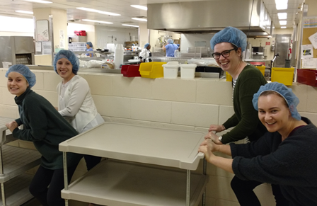 4 dietitian students who were running the empty carts back to the kitchen to restock their supply of food (they had planned for about half as many participants!)